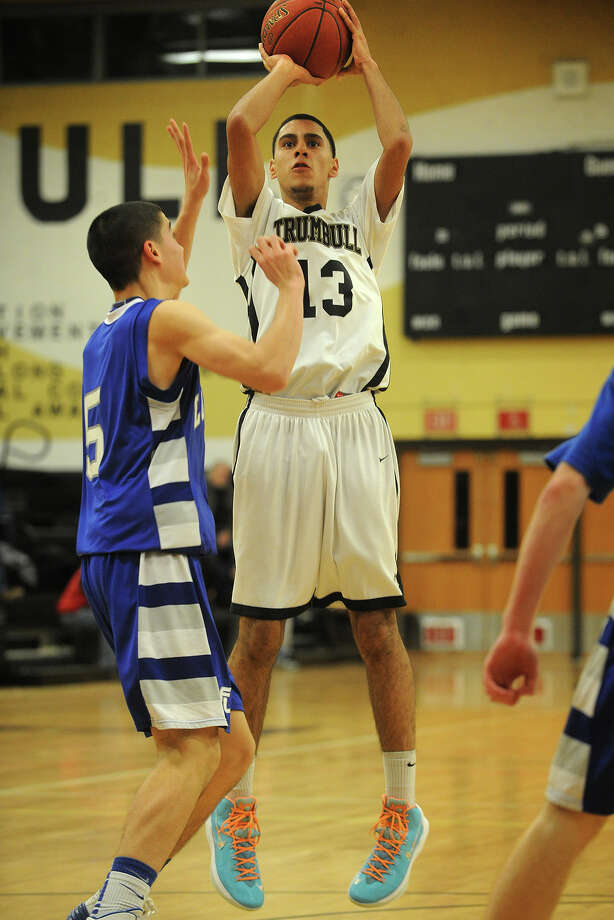 Trumbull's Rashard Rodriguez fires off a jumper over Fairfield Ludlowe defender Matt Doyle during their FCIAC boys basketball game at Trumbull High School in Trumbull, Conn. on Monday, January 6, 2013. Photo: Brian A. Pounds / Connecticut Post