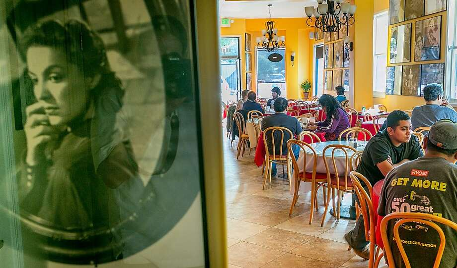 Bright, warm colors show off the black-and-white Mexican movie posters, above, that line the walls at Gallardos, where enchiladas de pollo, left, and beef soup, below, are just two of the hearty dishes on the menu. Photo: John Storey, Special To The Chronicle