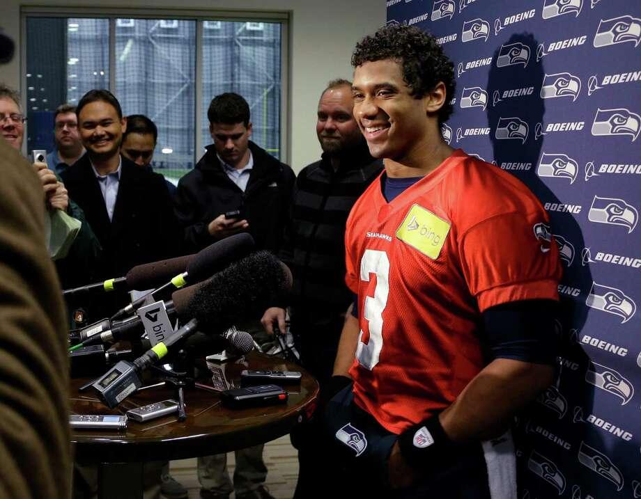 Seattle Seahawks NFL football quarterback Russell Wilson talks to reporters after practice, Thursday, Jan. 2, 2014 in Renton, Wash. (AP Photo/Ted S. Warren) ORG XMIT: WATW115 Photo: Ted S. Warren / AP