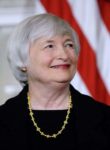 (FILES): This October 9, 2013 file photo shows economist Janet Yellen smiling as US President Barack Obama announces her nomination for as Federal Reserve chairman at the White House in Washington, DC.  The US Senate confirmed Federal Reserve vice chair Janet Yellen to be the new head of the world's most powerful central bank on January 6, 2014, the first woman ever to lead the Fed.  AFP Photo / Files / Jewel SamadJEWEL SAMAD/AFP/Getty Images Photo: JEWEL SAMAD, Staff / AFP ImageForum