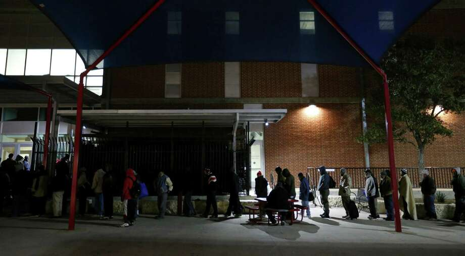 Homeless individuals line up earlier this year for sleeping pads and blankets at Haven for Hope. A reader comments on  efforts to keep the less fortunate from panhandling. Photo: Edward A. Ornelas, San Antonio Express-News / © 2014 San Antonio Express-News