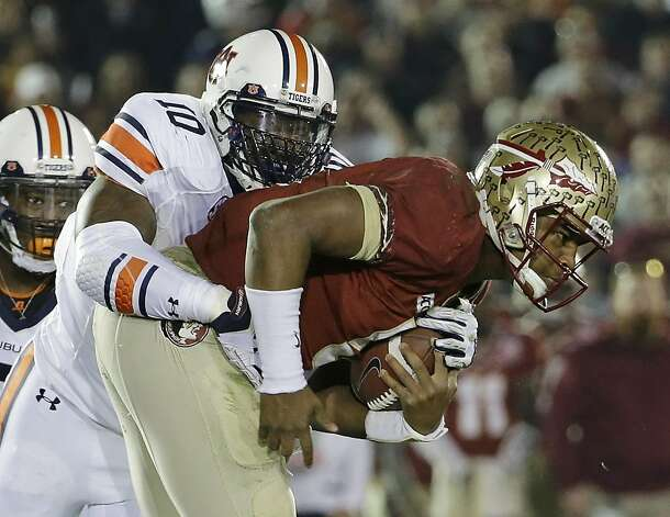Auburn's LaDarius Owens (10) sacks Florida State quarterback Jameis Winston during the second half of the NCAA BCS National Championship college football game Monday, Jan. 6, 2014, in Pasadena, Calif. (AP Photo/David J. Phillip) Photo: David J. Phillip, Associated Press