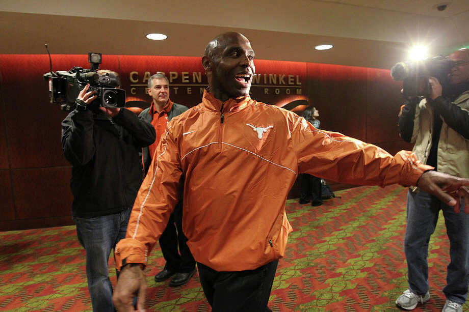 University of Texas Head Football Coach Charlie Strong leaves a staff meeting before a press conference at the campus in Austin, Monday, Jan. 6, 2014. Strong, 53, formerly Louisville coach, took the job Sunday night replacing Mack Brown. Photo: Jerry Lara, Staff / ©2013 San Antonio Express-News