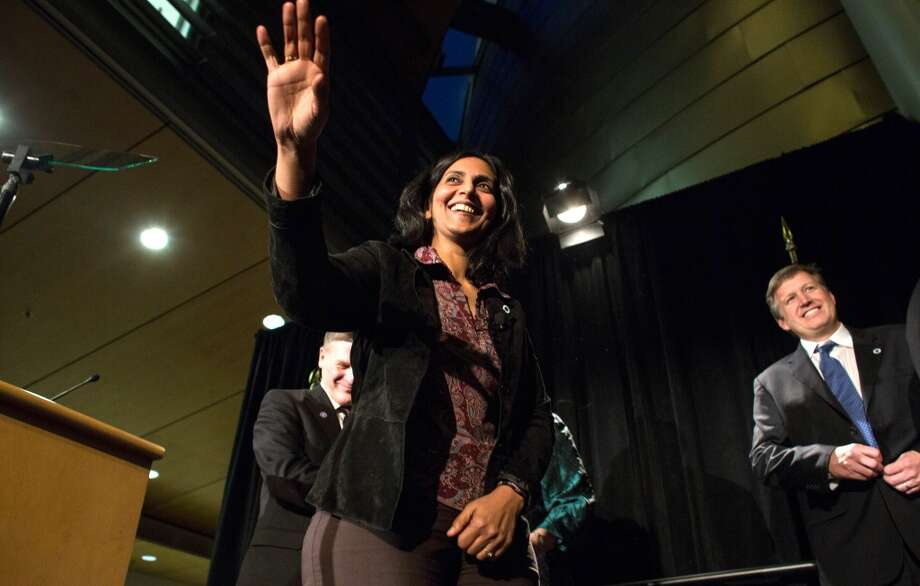 New Seattle City Councilmember Kshama Sawant waves from the podium after being sworn-in. Photo: JOSHUA TRUJILLO, SEATTLEPI.COM