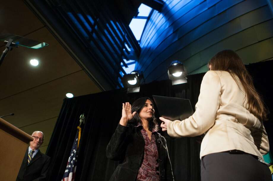 Seattle City Councilmember Kshama Sawant is sworn-in on Monday, January 6, 2014 at Seattle City Hall. Photo: JOSHUA TRUJILLO, SEATTLEPI.COM