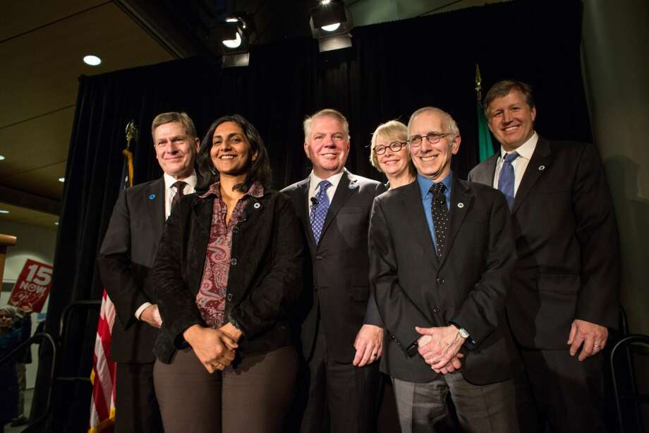From left, City Attorney Pete Holmes, City Councilmember Kshama Sawant, Mayor Ed Murray, Councilmember Sally Bagshaw, councilmember Nick Licata, and councilmember Mike O'Brien pose for a photo after a swearing-in ceremony on Monday, January 6, 2014 at Seattle City Hall. Photo: JOSHUA TRUJILLO, SEATTLEPI.COM