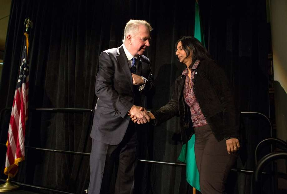 New Seattle Mayor Ed Murray and City Councilmember Kshama Sawant shake hands after being sworn-in on Monday, January 6, 2014 at Seattle City Hall. Photo: JOSHUA TRUJILLO, SEATTLEPI.COM