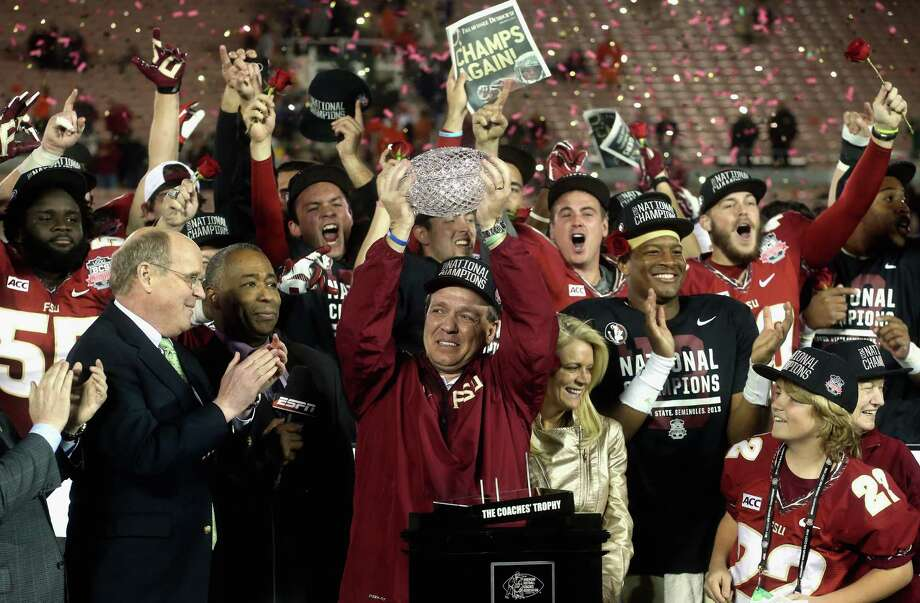 PASADENA, CA - JANUARY 06:  Florida State Seminoles head coach Jimbo Fisher holds the Coaches' Trophy after defeating the Auburn Tigers 34-31 in the 2014 Vizio BCS National Championship Game at the Rose Bowl on January 6, 2014 in Pasadena, California. Photo: Stephen Dunn, Getty Images / 2014 Getty Images