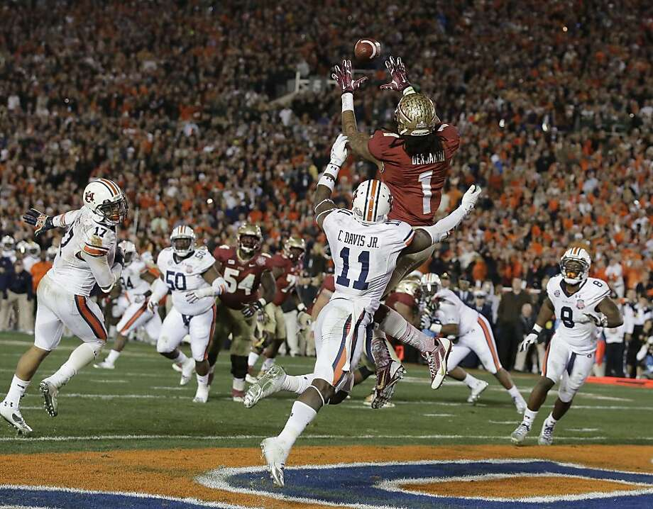 Florida State's Kelvin Benjamin reaches to catch Jameis Winston's pass for a 2-yard touchdown with 13 seconds left. The TD, the Seminoles' third of the fourth quarter, was a national-title-winning play. Photo: Chris Carlson, Associated Press