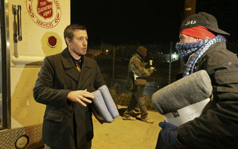 The Salvation Army staff was giving out blankets, hot drinks and offering rides to shelters to the homeless stuck in the cold. Photo: Edward A. Ornelas / San Antonio Express-News / © 2014 San Antonio Express-News