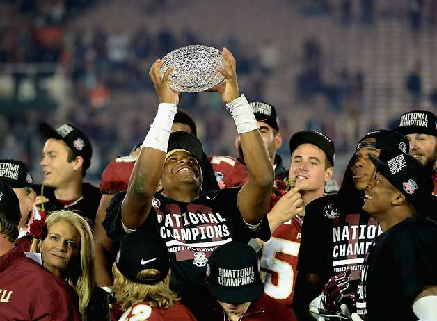 PASADENA, CA - JANUARY 06:  Quarterback Jameis Winston #5 of the Florida State Seminoles holds the Coaches' Trophy after defeating the Auburn Tigers 34-31 in the 2014 Vizio BCS National Championship Game at the Rose Bowl on January 6, 2014 in Pasadena, California.  (Photo by Harry How/Getty Images) Photo: Harry How, Getty Images