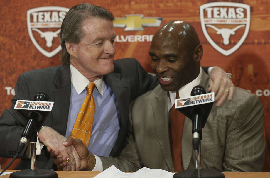 "Charlie Strong (right) is ""the right person,"" to lead the football program on and off the field, UT president Bill Powers said. Photo: Jerry Lara, San Antonio Express-News / ©2013 San Antonio Express-News"