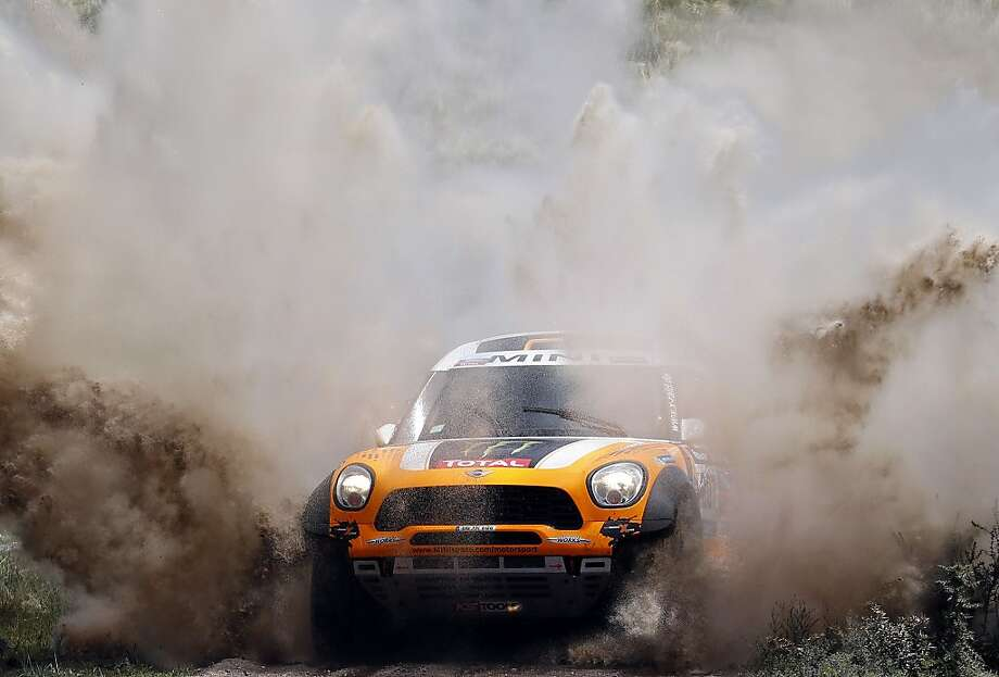 TOPSHOTS Mini's driver Orlando Terranova of Argentina, and co-driver Paulo Fiuza, compete during the Dakar Rally 2014 Stage 1 between Rosario and San Luis, Argentina, on January 5, 2014. AFP PHOTO / FRANCK FIFEFRANCK FIFE/AFP/Getty Images Photo: Franck Fife, AFP/Getty Images