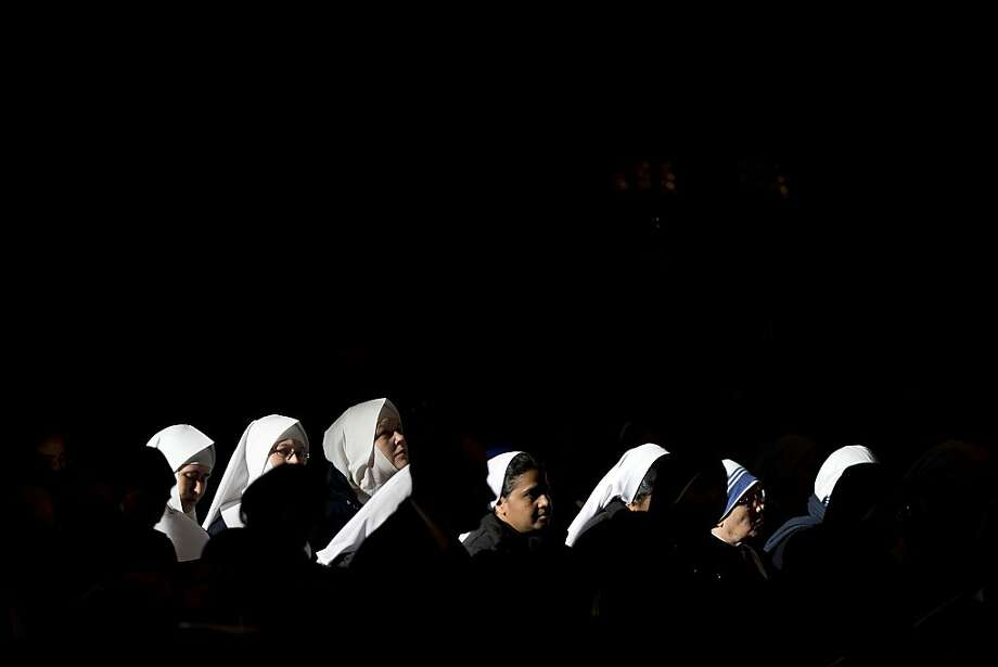 Nuns attend a Mass celebrated by Pope Francis in St. Peter's Basilica, the Vatican, to mark the Epiphany. Photo: Andrew Medichini, Associated Press