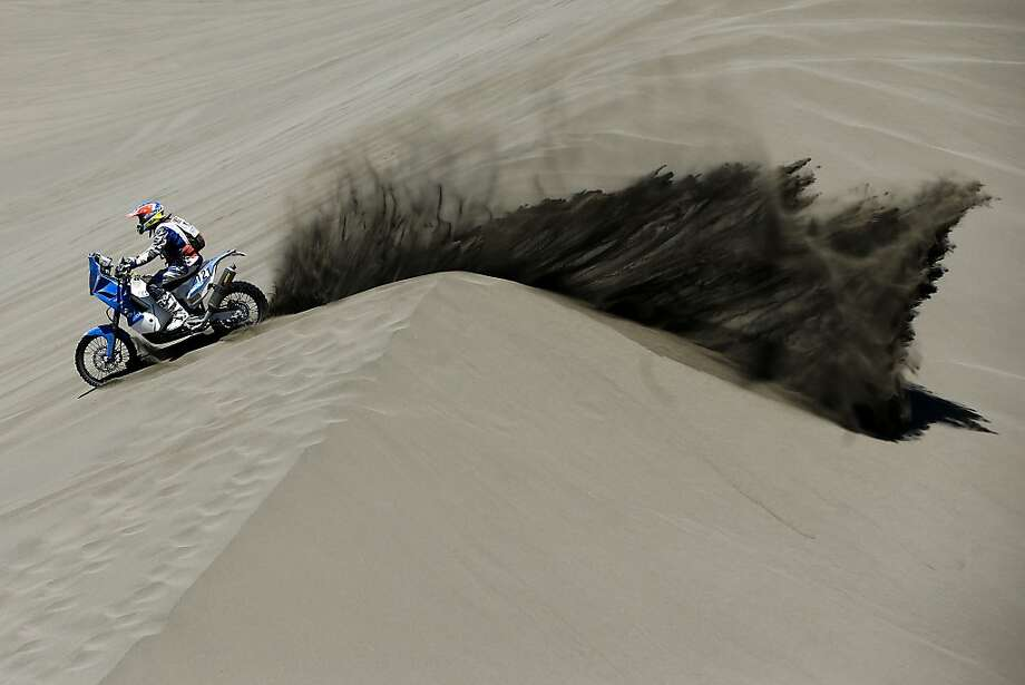 KTM rider Mark Davidson of Australia races through the dunes during the second stage of the Dakar Rally between the cities of San Luis and San Rafael in San Rafael, Argentina,  Monday, Jan. 6, 2014. The second stage is regarded as one of the fastest in the two-week rally, which ends Jan. 18 in Valparaiso, Chile. (AP Photo/Victor R. Caivano) Photo: Victor R. Caivano, Associated Press