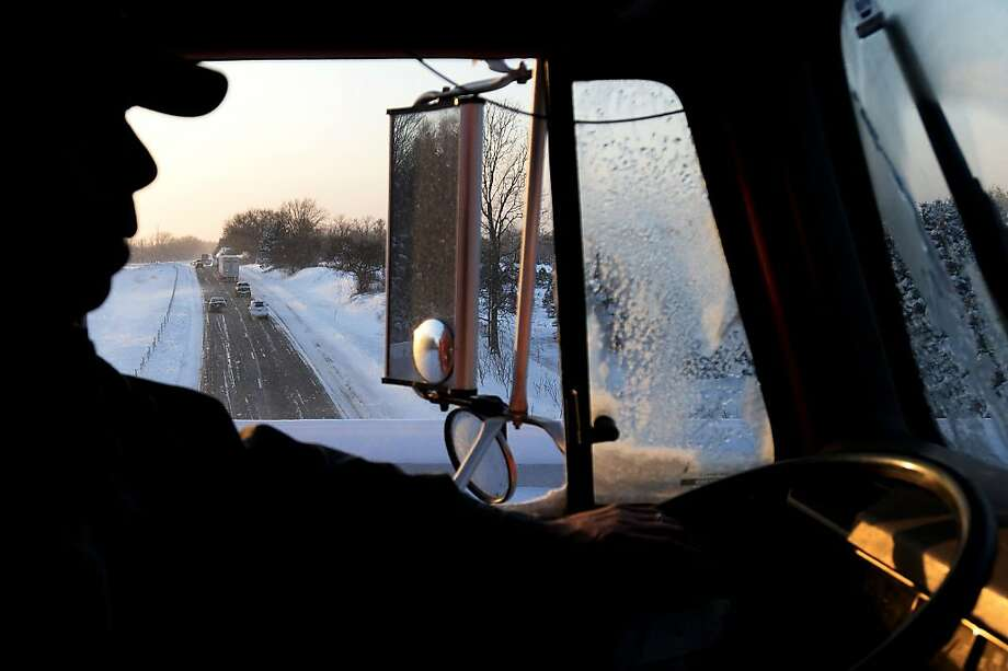 Eastbound I-94 is seen out of the window of Washtenaw County Road Commission group leader and plow driver Paul Schneider during his shift in Chelsea on Monday, Jan. 6, 2014.  (AP Photo/The Ann Arbor News, Melanie Maxwell) Photo: Melanie Maxwell, Associated Press