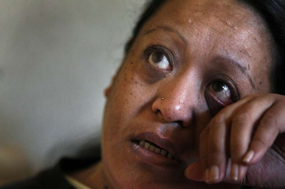 Agnes Faafiu cries as she talks about her family and finding out that she has kidney failure, Tuesday November 9, 2013, in Oakland, Calif. She received help from Season of Sharing, who paid two months of  rent after she had fallen behind due to her being sick. Photo: Lacy Atkins, The Chronicle