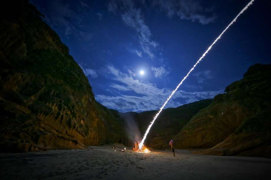 """Phuket, Thailand.  Unexpected fireworks  here can include those lit on a beach to those arising from lit people enjoying the """"sketchy"""" clubs, go-go bars, massage parlors  and """"ladyboys"""" of Patong, the Thai island's busiest party town, per """"101 Places."""" Photo: Katie Scott Aiton"""