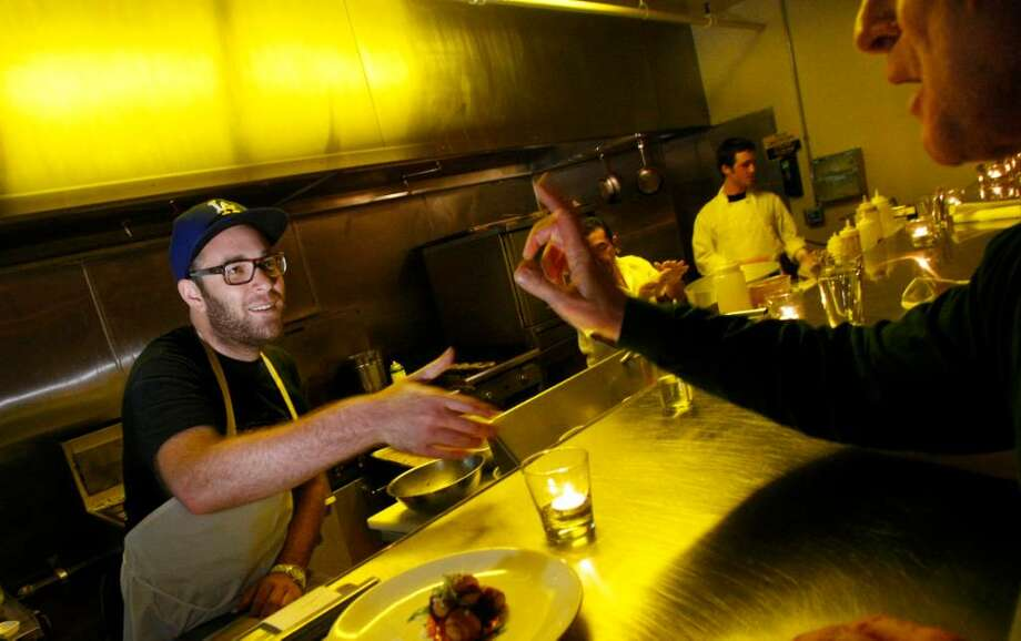 A customer stops by to tell Chef Ilan Hall, left, how much he enjoyed the meal at The Gorbals in the historic Alexandria Hotel in downtown Los Angeles, January 21, 2010. (Anne Cusack/Los Angeles Times/MCT) Photo: Anne Cusack, MCT / Los Angeles Times
