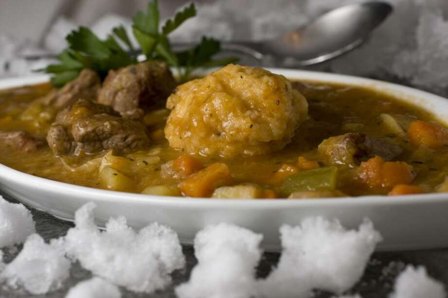 This photo taken Jan. 3, 2010 shows three-onion lamb stew with dumplings. A large dumpling sits like a curling stone on the ice when serving this three-onion lamb stew with dumplings. (AP Photo/Larry Crowe) Photo: Larry Crowe, ASSOCIATED PRESS / AP2010