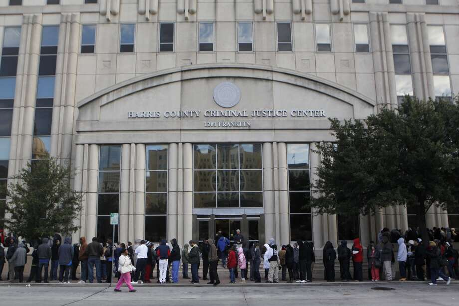All but one elevator going to floors 2-10 at the Harris County Criminal Justice Center were out Tuesday morning, causing major backups and long lines as hundreds wait. Photo: Johnny Hanson, Houston Chronicle