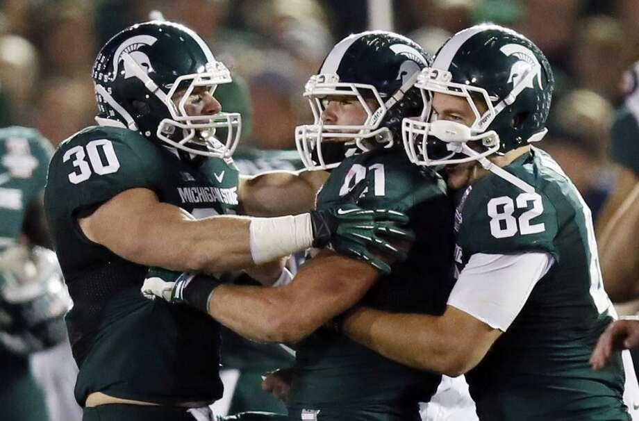 3. Michigan State (13-1) Previous ranking: 4 Photo: Danny Moloshok, Associated Press