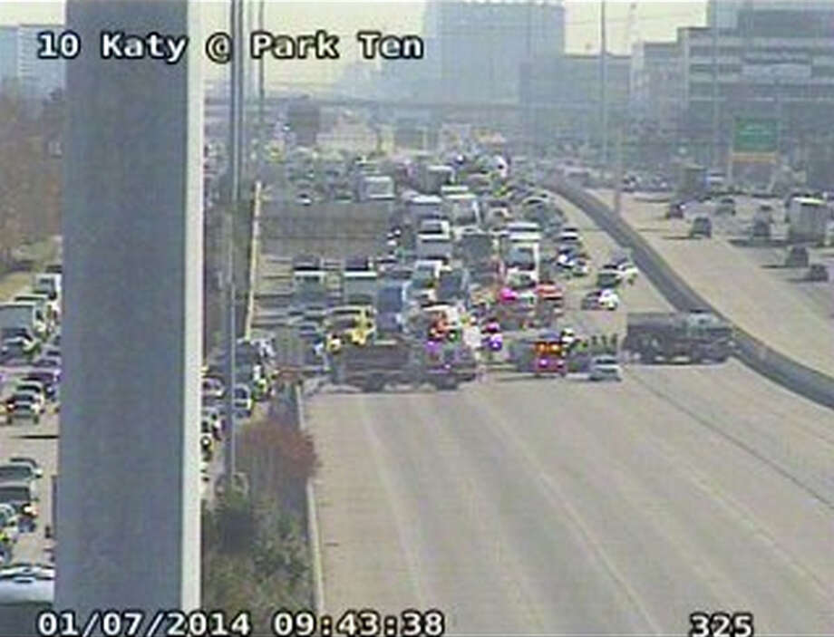 A two-vehicle wreck left one person dead Tuesday morning on the Katy Freeway in far west Houston. The interstate was blocked near the wreck. Photo: Houston Transtar