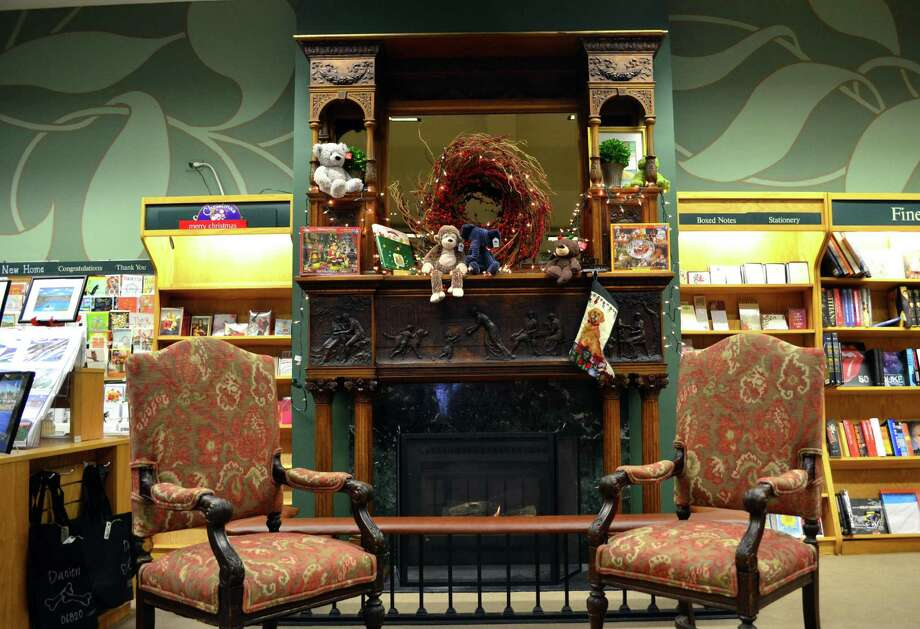 The solid oak fireplace on the  back wall of Barrett  Bookstore belonged to Sheila Daley's great-grandfather. It was in the library of his New York brownstone. Photo: Megan Spicer / Darien News
