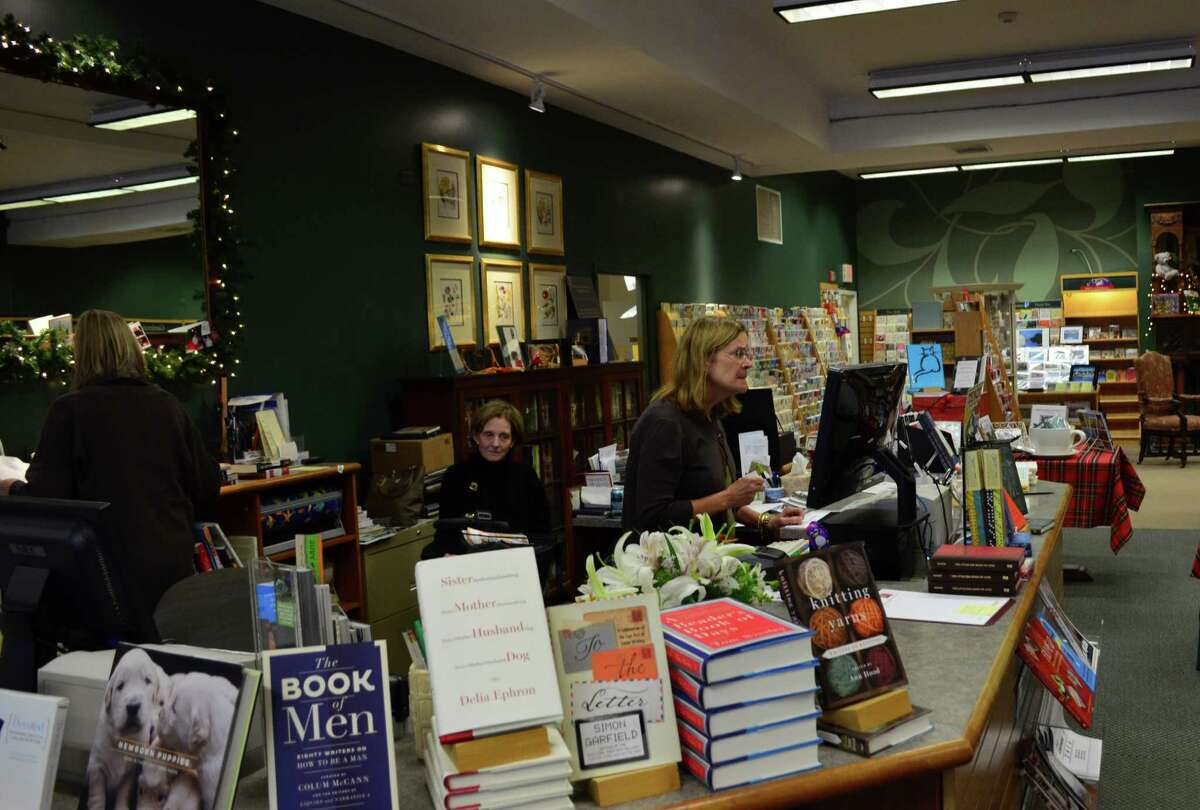 Roasanna Nissen, the events coordinator, Sheila Daley, the owner, and Robin Harvey, a an employee of 16 years, at Barrett Bookstore in Darien, Conn.