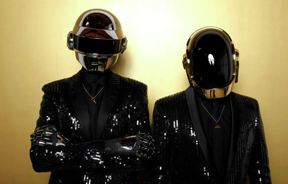 FILE - In this April 17, 2013 file photo, Thomas Bangalter, left, and Guy-Manuel de Homem-Christo, from the group Daft Punk pose for a portrait in Los Angeles. The Recording Academy announced Thursday, Dec. 19, 2013, that Daft Punk will perform at the Grammy Awards show on Jan. 26, 2014. (Photo by Matt Sayles/Invision/AP, File) ORG XMIT: NY117 Photo: Matt Sayles / Invision