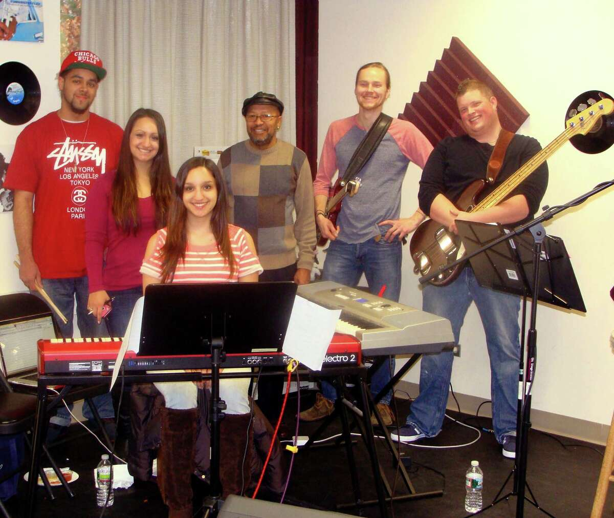 Instructors from the Pop Music Academy will accompany singers, musicians and professional performers at the annual showcase Jan. 25 to benefit the Stamford Hospitalís Bennett Cancer Center Music Therapy Program. Band members, from left, are Josh Carruthers on drums, Artistic Director Christine Occhino on vocals, Lisa Occhino on keyboard, Richard