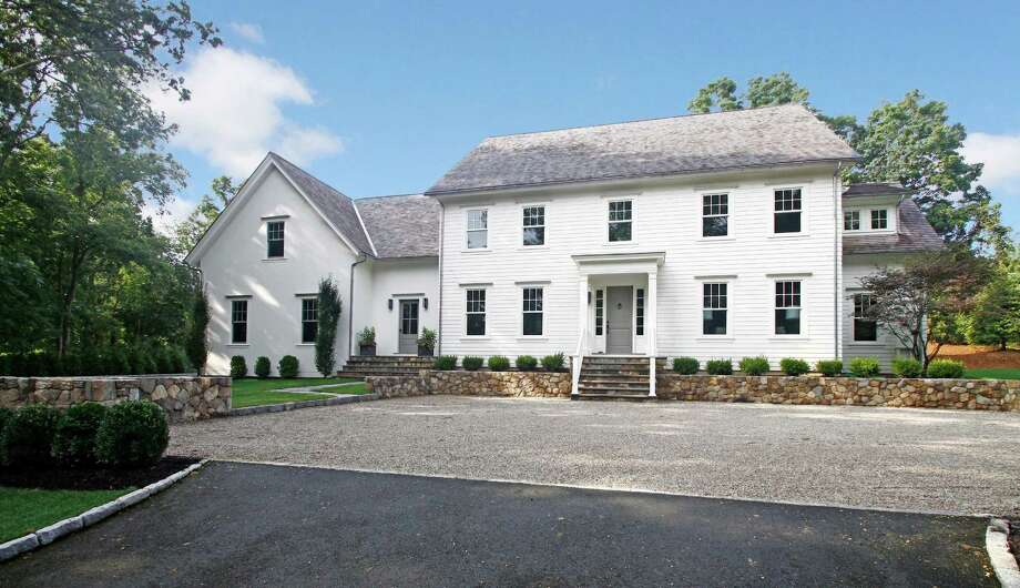 New construction was a hot commodity in Westport in 2013 and contributed to the market rebound. This custom Colonial on Long Lots Road, built by NEST Development, closed at $2,750,000. Photo: Contributed Photo / Westport News
