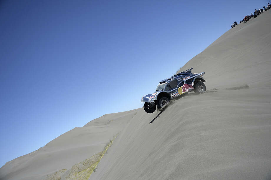 France's Roan Chabot and co-driver Gilles Pillot, compete in their SMG during the Stage 2 of the Dakar 2014 between San Luis and San Rafael, Argentina, on January 6, 2014. Photo: FRANCK FIFE, AFP/Getty Images / 2014 AFP