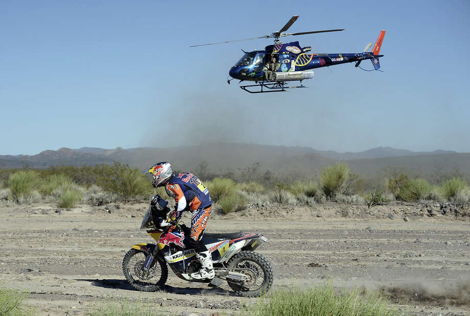 Spains' Marc Coma rides his KTM during the 2014 Dakar Rally Stage 2 between San Luis and San Rafael, Argentina, on January 6, 2014. Photo: FRANCK FIFE, AFP/Getty Images / 2014 AFP