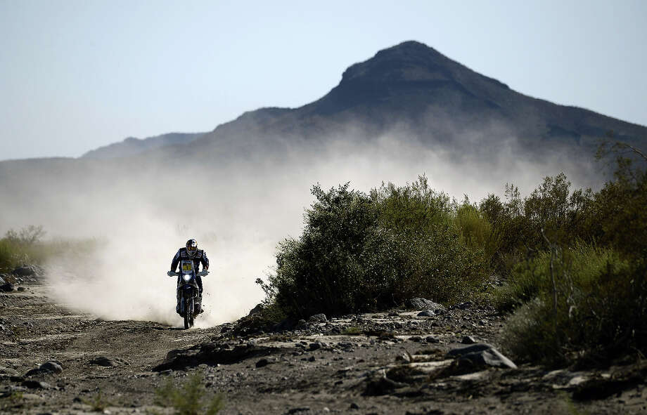 French rider Cyril Despres powers his KTM during the 2014 Dakar Rally Stage 2 between San Luis and San Rafael, Argentina, on January 6, 2014. Photo: FRANCK FIFE, AFP/Getty Images / 2014 AFP
