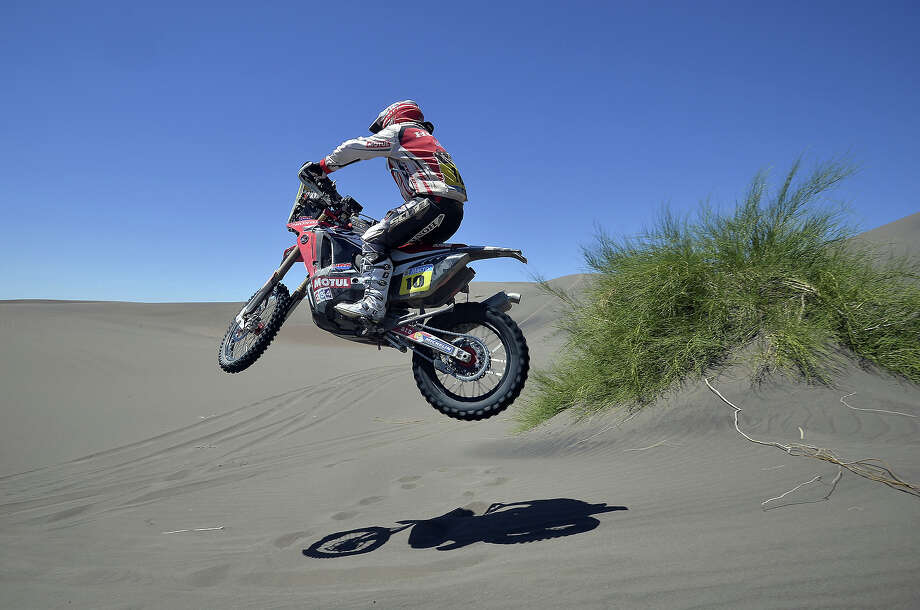 KTM rider Paulo Goncalves of Portugal jumps during the 2014 Dakar Rally Stage 2 between San Luis and San Rafael, Argentina, on January 6, 2014. Photo: FRANCK FIFE, AFP/Getty Images / 2014 AFP