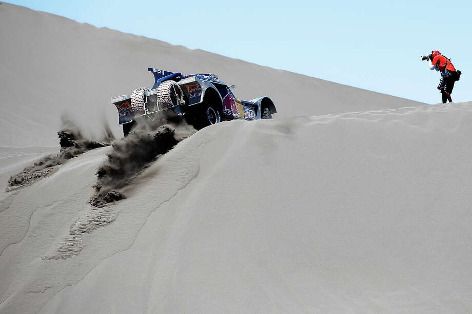 Ronan Chabot and Gilles Pillot of France for Smg-Red Bull Rally Team competes on Day 2 of the Dakar Rally 2014 on January 6, 2014 in the Dunes of Nihuil, Argentina. Photo: Dean Mouhtaropoulos, Getty Images / 2014 Getty Images