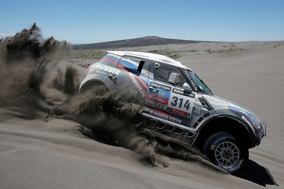 Vladimir Vasilyev and Vitaliy Yevtyekhov of Russia for MINI X-Raid Team compete on Day 2 of the Dakar Rally 2014 on January 6, 2014 in the Dunes of Nihuil, Argentina. Photo: Dean Mouhtaropoulos, Getty Images / 2014 Getty Images