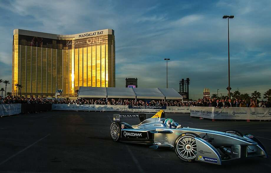 Lucas di Grassi demonstrates the new Spark-Renault electric race car from Formula E in a parking lot behind Mandalay Bay. Photo: Joe Klamar, AFP/Getty Images