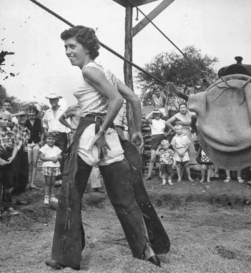A woman rubs herself after attempting to ride a bucking barrel that rides like a horse on Mayan Dude Ranch.  (Photo by John Dominis//Time Life Pictures/Getty Images) Photo: John Dominis, Time & Life Pictures/Getty Image / Time Life Pictures