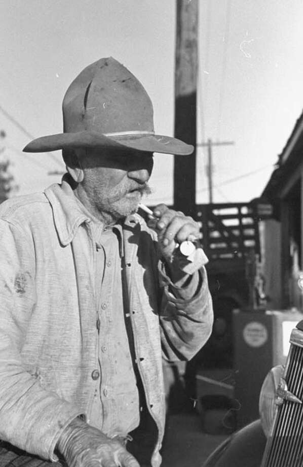 Old time cattleman Willian Culpepper smokes a cigarette while working on the cattle ranch.  (Photo by Carl Mydans//Time Life Pictures/Getty Images) Photo: Carl Mydans, Time & Life Pictures/Getty Image / Time Life Pictures