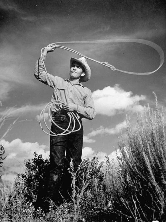 A cowboy at the Matador ranch in Texas swings his lasso.  (Photo by Hansel Mieth//Time Life Pictures/Getty Images) Photo: Hansel Mieth, Time & Life Pictures/Getty Image / Time Life Pictures