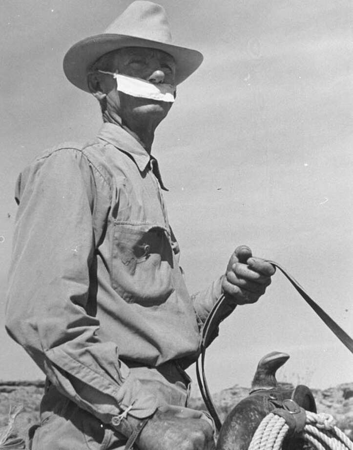 A cowboy wears a piece of cloth over the lower part of his face to keep the sun from blistering his lips.  (Photo by Carl Mydans//Time Life Pictures/Getty Images) Photo: Carl Mydans, Time & Life Pictures/Getty Image / Time Life Pictures