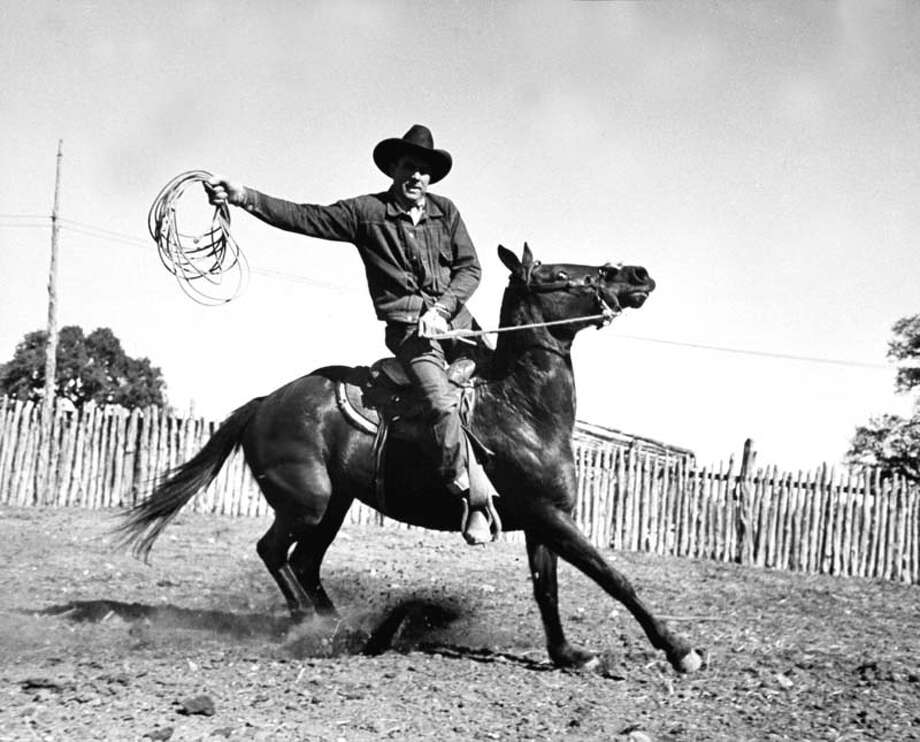 A cowboy rides a horse.  (Photo by Carl Mydans//Time Life Pictures/Getty Images) Photo: Carl Mydans, Time & Life Pictures/Getty Image / Time Life Pictures