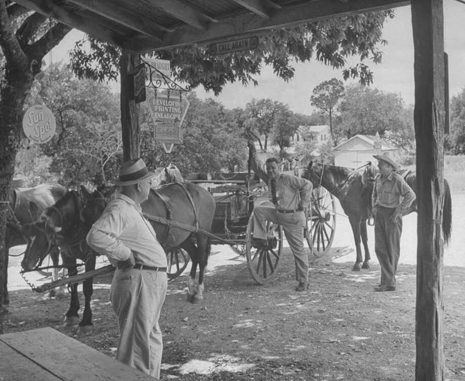 Men arrive by horseback and by wagon to shop at local store.  (Photo by Hans Wild//Time Life Pictures/Getty Images) Photo: Hans Wild, Time & Life Pictures/Getty Image / Time Life Pictures