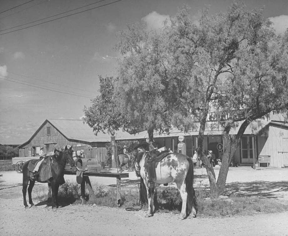 Customers arrive by horseback to shop at local store, with mailboxes close by.  (Photo by Hans Wild//Time Life Pictures/Getty Images) Photo: Hans Wild, Time & Life Pictures/Getty Image / Time Life Pictures