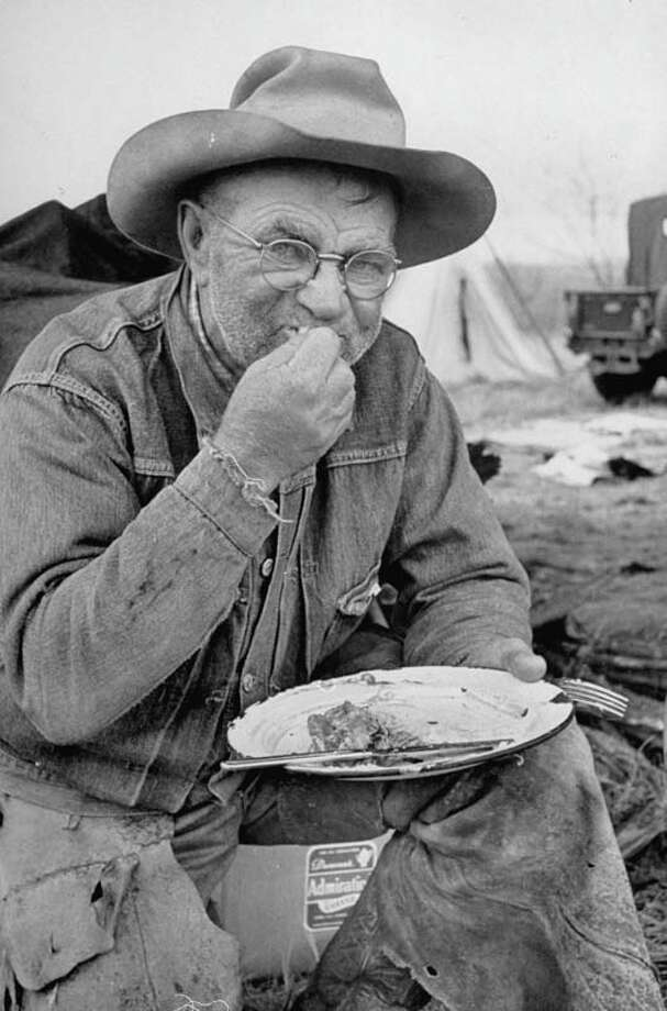 A wrangler eats dinner.  (Photo by Leonard Mccombe//Time Life Pictures/Getty Images) Photo: Leonard McCombe, Time & Life Pictures/Getty Image / Leonard Mccombe