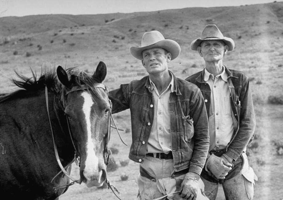 Cowboy Clarence H. Long (C) standing with horse and other cowboy.  (Photo by Leonard Mccombe//Time Life Pictures/Getty Images) Photo: Leonard McCombe, Time & Life Pictures/Getty Image / Leonard Mccombe