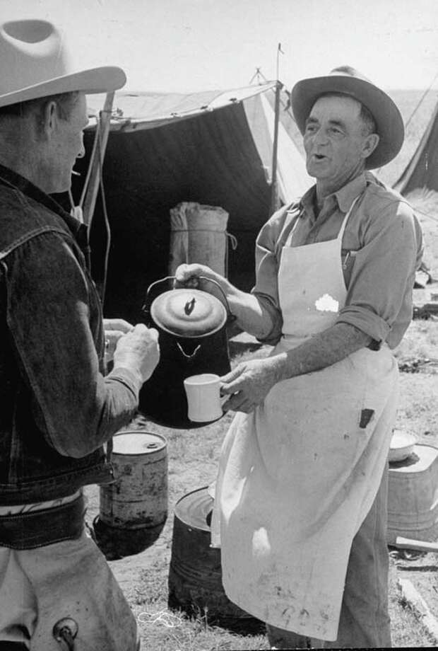 Cowboy Clarence H. Long (L) talks with cook Bud Reed.  (Photo by Leonard Mccombe//Time Life Pictures/Getty Images) Photo: Leonard McCombe, Time & Life Pictures/Getty Image / Leonard Mccombe