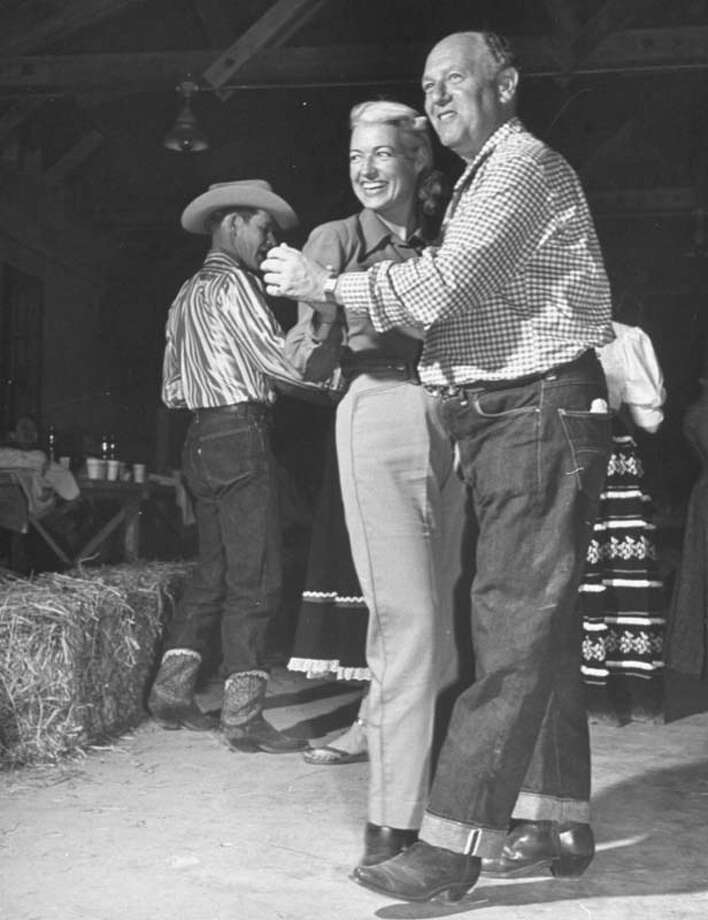 Designer De De Johnson dances with Earl Kronthal at the Flying L Ranch resort.  (Photo by Cornell Capa//Time Life Pictures/Getty Images) Photo: Cornell Capa, Time & Life Pictures/Getty Image / Time & Life Pictures